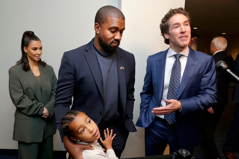 Kim Kardashian West, North West, Kanye West and Joel Osteen after the 11 a.m. service at Lakewood Church on Sunday in Houston. (Michael Wyke/AP)