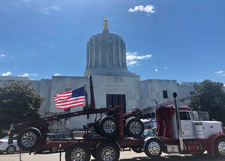 A truck moves around the Oregon state Capitol during a protest against climate bills.  (Sarah Zimmerman, File)